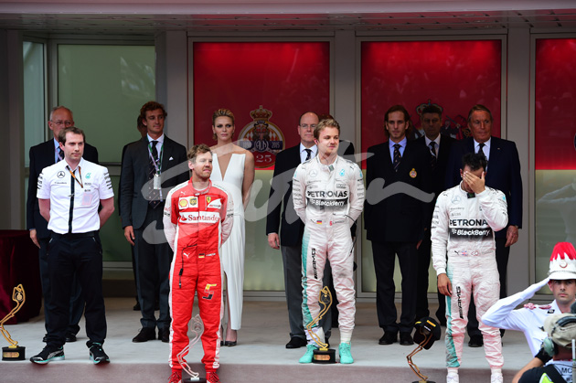 (L to R): Second placed Sebastian Vettel (GER) Ferrari, race winner Nico Rosberg (GER) Mercedes AMG F1 and third placed Lewis Hamilton (GBR) Mercedes AMG F1 on the podium at Formula One World Championship, Rd6, Monaco Grand Prix Race, Monte-Carlo, Monaco, Sunday 24 May 2015. BEST IMAGE