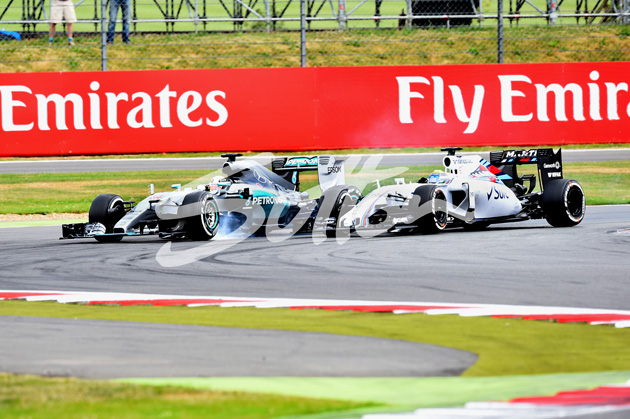 Lewis Hamilton (GBR) Mercedes AMG F1 W06 and Felipe Massa (BRA) Williams FW37 battle at Formula One World Championship, Rd9, British Grand Prix, Race, Silverstone, England, Sunday 5 July 2015. BEST IMAGE