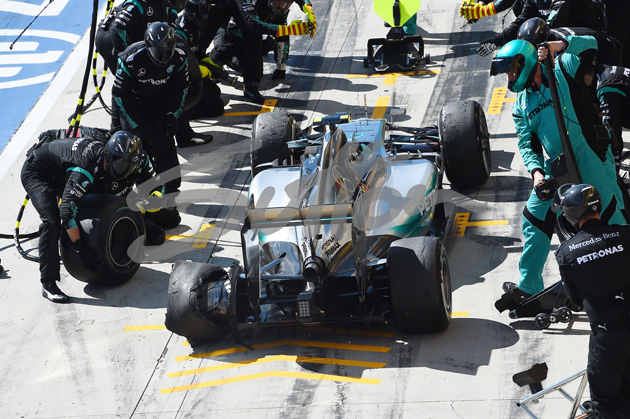 Nico Rosberg (GER) Mercedes AMG F1 W06 pit stop with rear puncture at Formula One World Championship, Rd10, Hungarian Grand Prix, Race, Hungaroring, Hungary, Sunday 26 July 2015. BEST IMAGE
